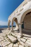 Amazing White chuch and seascape in town of Parakia, Paros island, Greece Stock Photo
