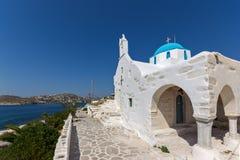 Amazing White chuch and seascape in town of Parakia, Paros island, Greece Royalty Free Stock Photo