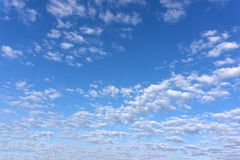 Amazing white clouds of unusual shape on blue sky background.  royalty free stock images