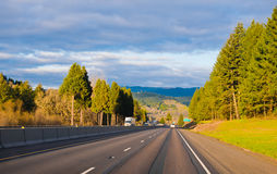 Amazing wide interstate highway in sunshine toll trees green div Stock Image
