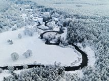 Amazing wild river in blue frozen forest. Really snowly winter on the north. Aerial panoramic view stock photos