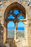 Amazing window view from the St. Hilarion Castle in Northern Cyprus. The popular view point offers a beautiful view over Cypriot. Kyrenia region and stock photos
