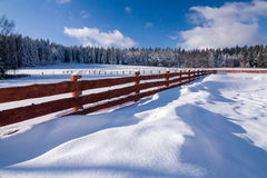 Amazing winter countryside with wooden fence Royalty Free Stock Images