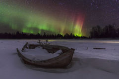 Amazing winter landscape with northern lights stock photos