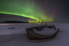Amazing winter landscape with northern lights. And stars Royalty Free Stock Photography