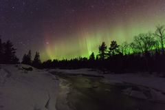 Amazing winter landscape with northern lights royalty free stock photo