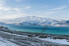 Amazing winter landscape of the Tien Shan mountains and Charvak reservoir on a clear winter day