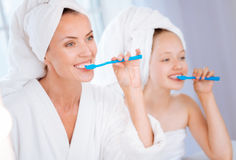 Amazing woman doing morning procedure with her kid Stock Image
