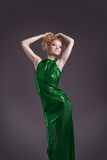 Amazing woman posing in transparent green costume Stock Image