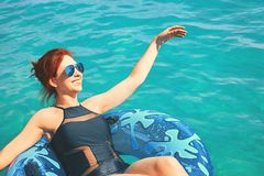Woman relax on inflatable ring in sea water. Amazing woman relax on inflatable ring in sea water royalty free stock photography