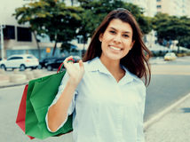 Amazing woman with shopping bags in vintage cinema look Royalty Free Stock Photo