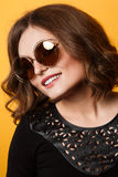 Amazing woman trendy, mirrored sunglasses, short wavy hair. Stock Photography