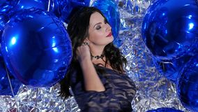 Amazing woman among vivid balloons against sparkling wall on photoshoot. Amazing woman with long hair among vivid balloons against sparkling wall on photoshoot stock video