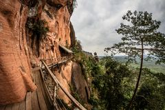 Amazing wooden pathway at Wat Phu Tok temple, Thailand Royalty Free Stock Image