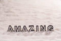 Amazing word on white sand stock image