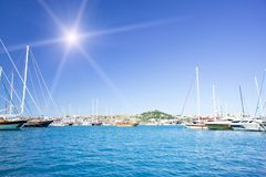 Amazing yachts and fun sun in the sky. Royalty Free Stock Photography