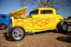 Amazing yellow hot rod with chrome Stock Images