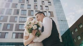 Amazing young beautiful couple. The guy and the girl are embracing each other against the backdrop of beautiful buildings. The gir stock footage