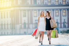 Amazing young female models blonde and brunette walking in the c Royalty Free Stock Image