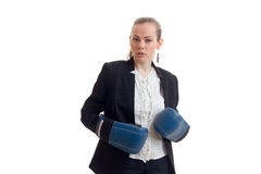 Amazing young girl standing in boxing gloves and a black jacket Stock Photo
