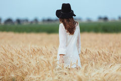 Amazing young lady in the field. Looking aside. Back view image of amazing young lady in the field. Looking aside royalty free stock image