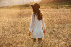 Amazing young lady in the field. Looking aside. Back view image of amazing young lady in the field. Looking aside royalty free stock photos