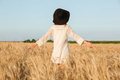 Amazing young lady in the field. Looking aside. Back view image of amazing young lady in the field. Looking aside stock image