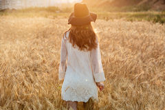 Amazing young lady in the field. Looking aside. Back view image of amazing young lady in the field. Looking aside royalty free stock images