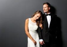 Amazing young newlywed couple. Portrait of amazing young newlywed couple with dark background Stock Images