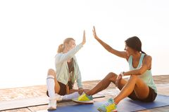 Amazing young two sports women gives a high-five to each other. stock photos