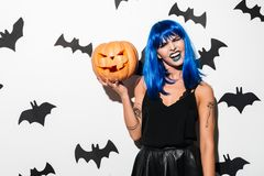 Amazing young woman in witch halloween costume Royalty Free Stock Photo