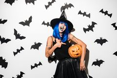 Amazing young woman in witch halloween costume Royalty Free Stock Images