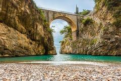 Amazingly beautiful beach under the bridge Royalty Free Stock Images