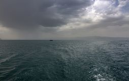 Dramatic sky over Lake Ohrid with boats on the horizon. Northern Macedonia. stock images