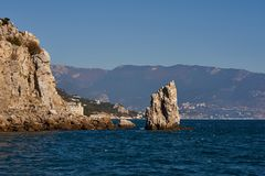 Amazingly beautiful Rock Sail stands in the Black Sea near the Crimean city of Yalta. The blue of the sea, sky and mountains as a royalty free stock images