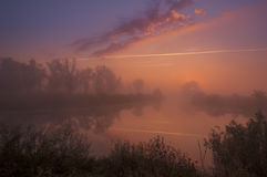 Amazingly beautiful sunrise over Lake, foggy Stock Image