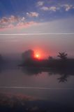 Amazingly beautiful sunrise over Lake, foggy Stock Photos