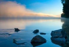 Amazingly beautiful sunrise over Lake, foggy Stock Images