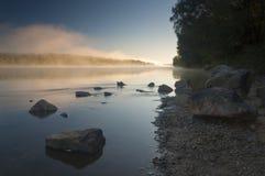 Amazingly beautiful sunrise over Lake, foggy Royalty Free Stock Photos