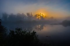 Amazingly beautiful sunrise over Lake, foggy Royalty Free Stock Photography