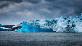 The amazingly blue iceberg floating in lagoon stock photo