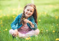 Little girl collecting flowers royalty free stock photography