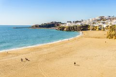 Amazingly wide, almost empty Fishermen Beach in Albufeira, Algar. Amazingly wide, almost empty beach along cliffs in Albufeira, Algarve, Portugal Royalty Free Stock Photos