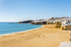 Amazingly wide, almost empty Fishermen Beach in Albufeira, Algar. Amazingly wide, almost empty beach along cliffs in Albufeira, Algarve, Portugal Stock Image