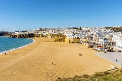 Amazingly wide, almost empty Fishermen Beach in Albufeira, Algar. Amazingly wide, almost empty beach along cliffs in Albufeira, Algarve, Portugal Royalty Free Stock Images