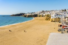 Amazingly wide, almost empty Fishermen Beach in Albufeira, Algar. Amazingly wide, almost empty beach along cliffs in Albufeira, Algarve, Portugal Royalty Free Stock Photo