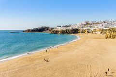 Amazingly wide, almost empty Fishermen Beach in Albufeira, Algarve. Amazingly wide, almost empty beach along cliffs in Albufeira, Algarve, Portugal Royalty Free Stock Photos