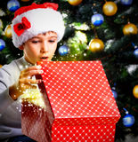 Amazment child opens the box with  christmas gifts Royalty Free Stock Photo