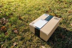 Amazon box in garden grass Royalty Free Stock Image