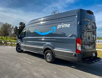 An Amazon delivery van with the Prime logo